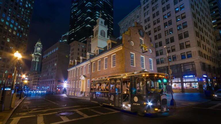 old state house boston at night with ghost trolley tour