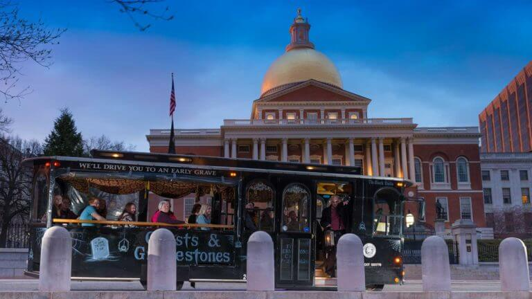 boston state house with haunted trolley in front