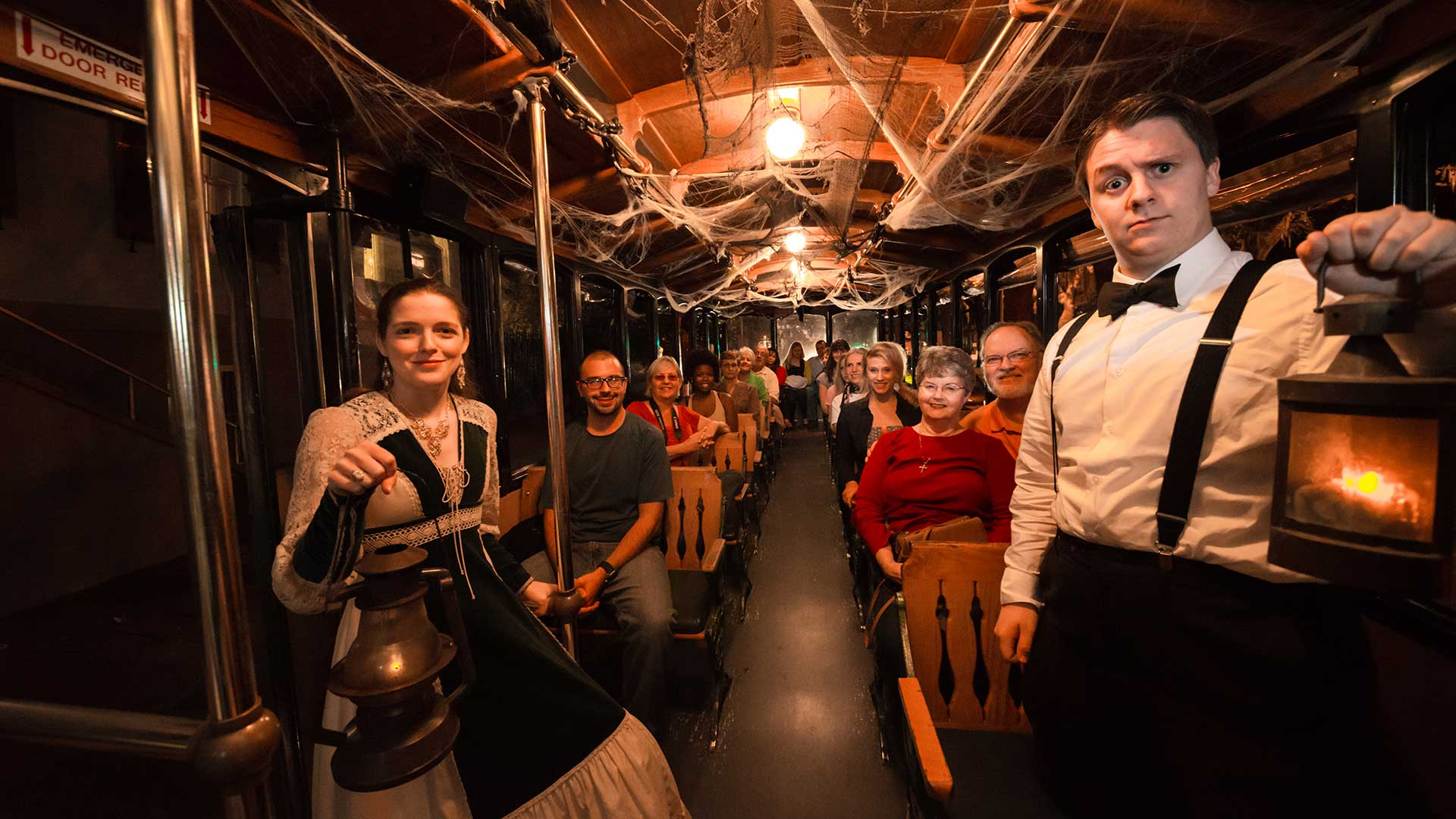 inside savannah haunted tour trolley with tour guides