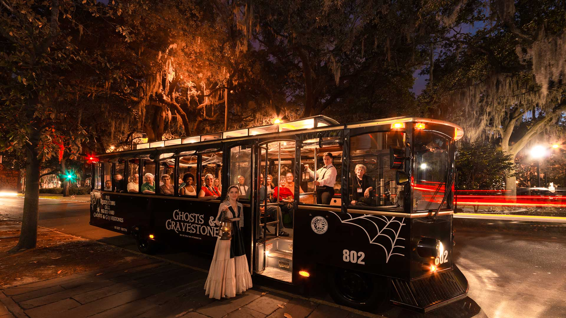 savannah haunted trolley tour guide holding lantern