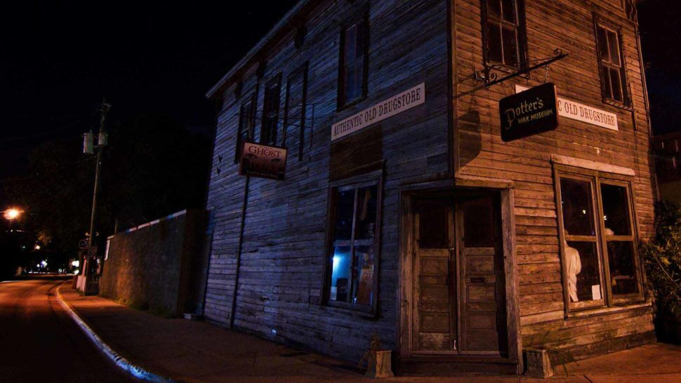 entrance to potters wax museum at night