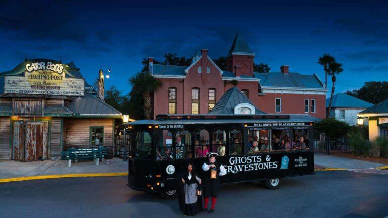 st augustine ghost tour guides in front of black trolley