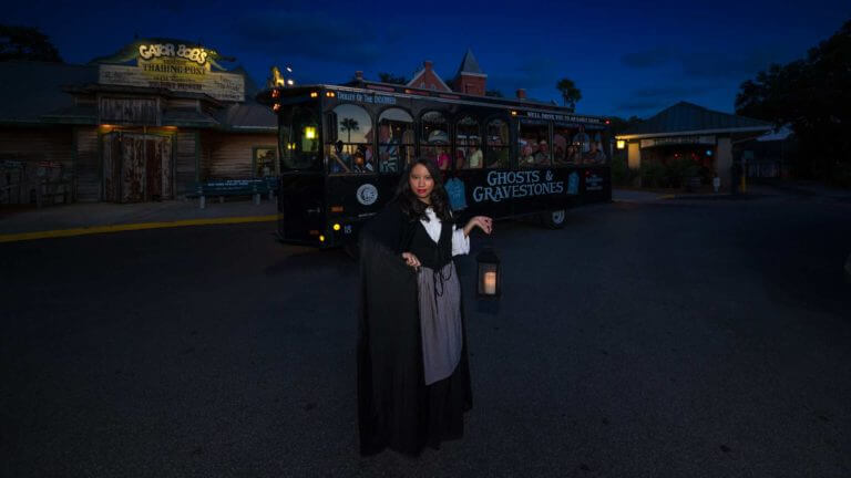 st augustine ghost tour guide holding lantern at night