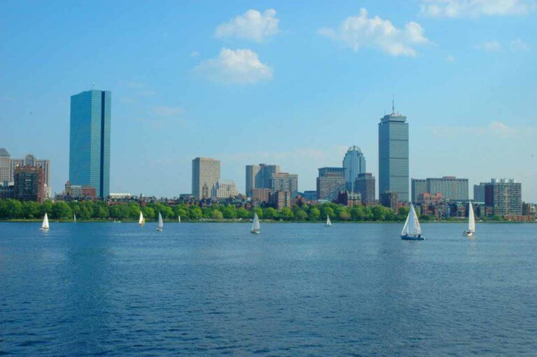 Boston's Back Bay, several sailboats and a view of a portion of the skyline