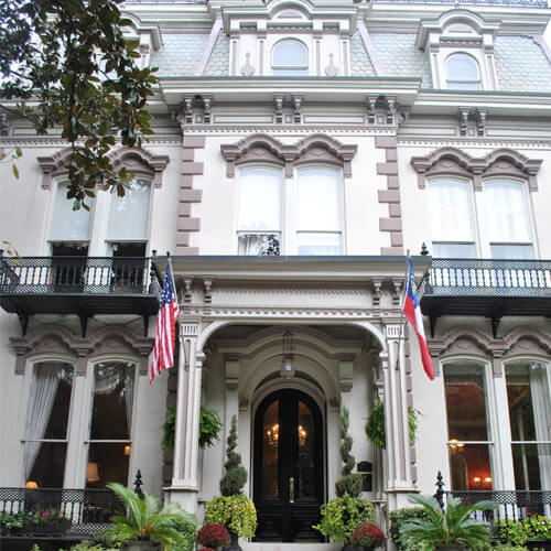 The exterior of the elegant Hamilton Turner Inn, a three-story building done in the Victorian style in Savannah