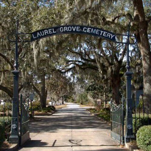The entrance to the Laurel Grove Cemetery under a canopy of Spanish Moss in Savannah