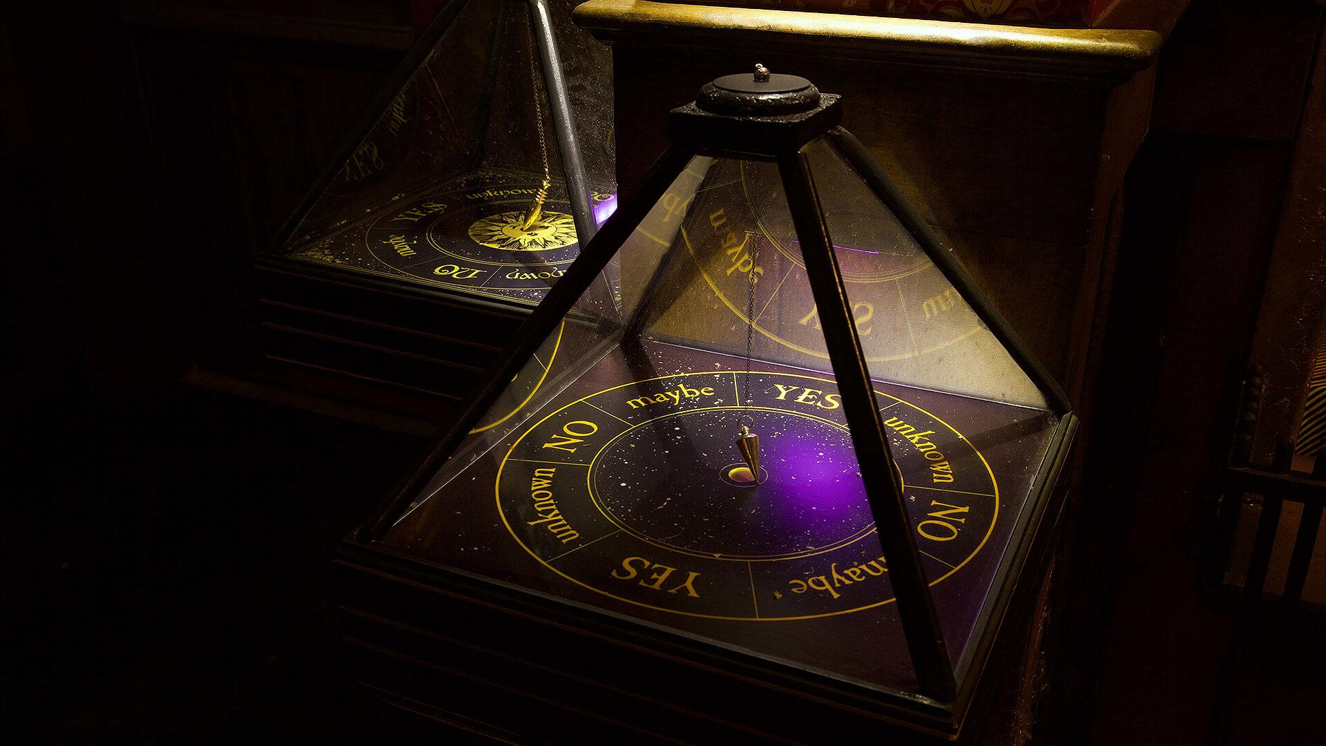 Ouija board and pendulum