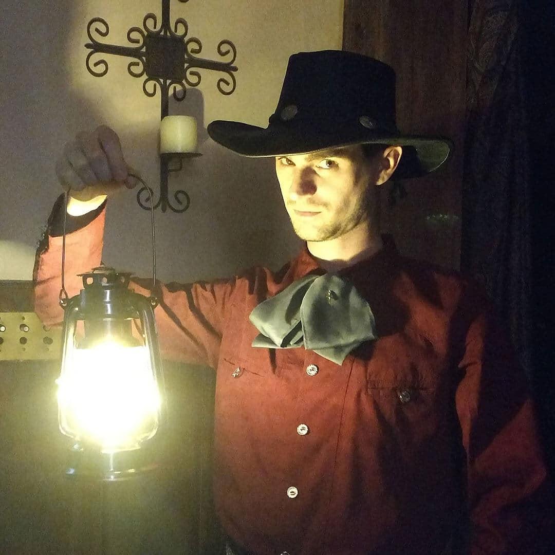 San Diego ghost host El Charro holding a lantern