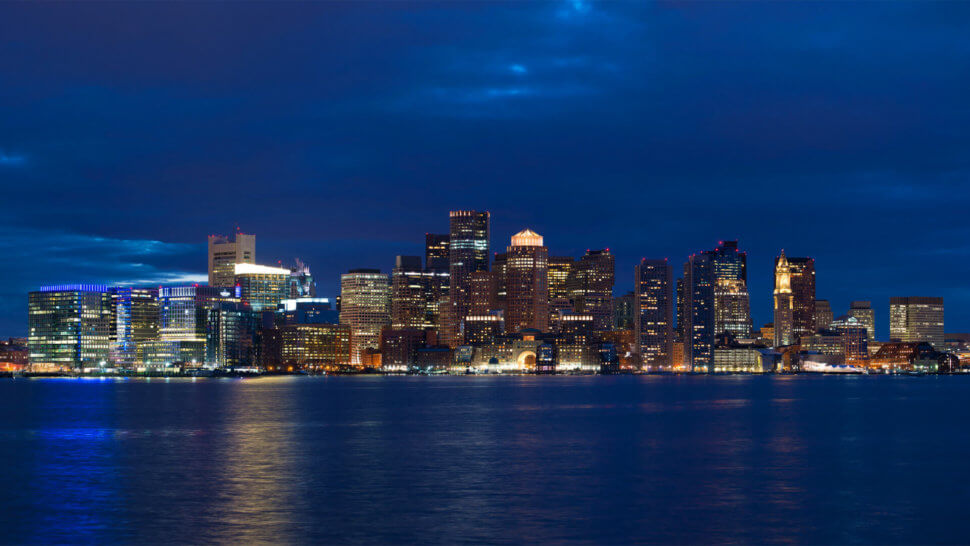 Skyline view of Boston at night during a Boston ghost tour