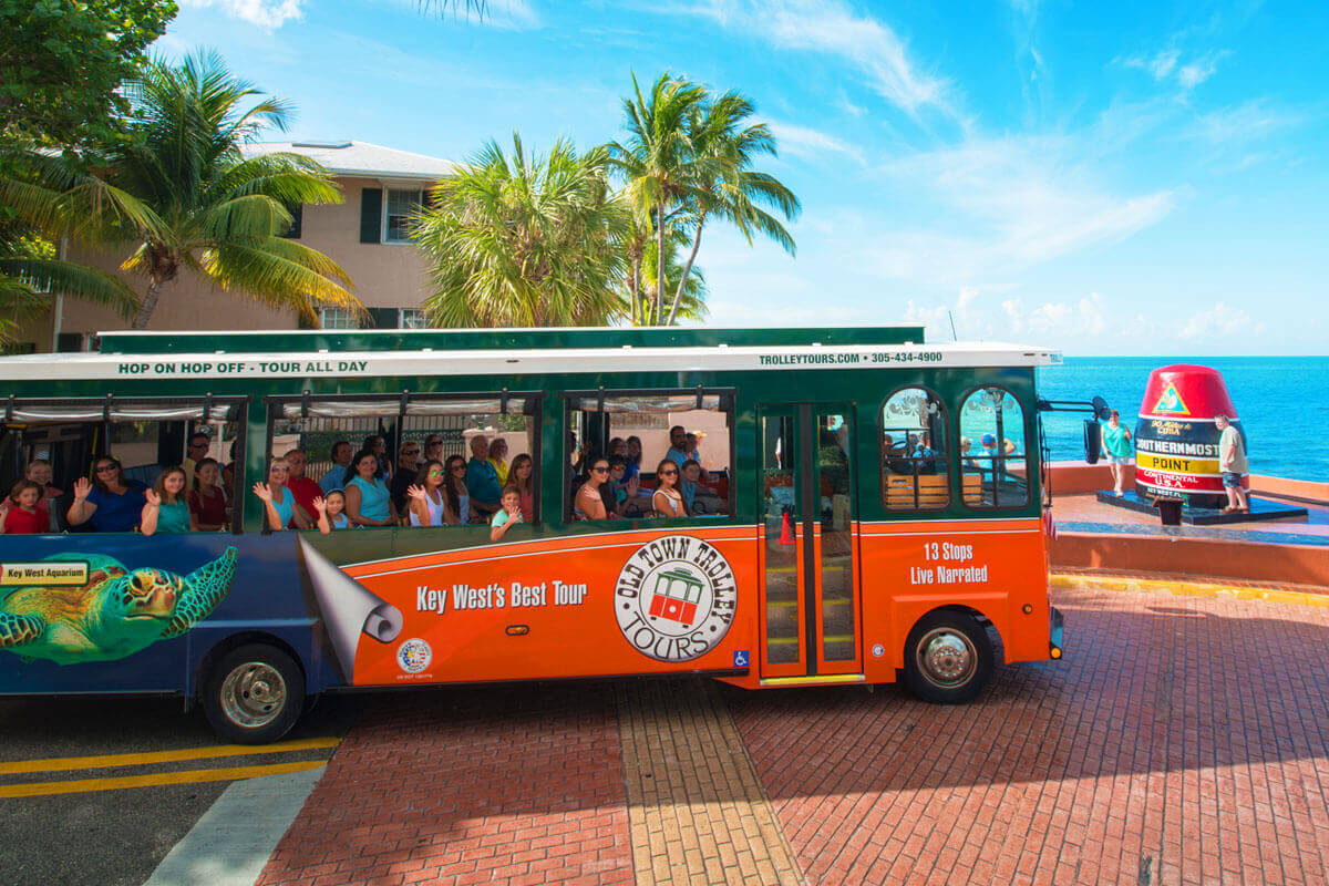 Key West Old Town Trolley driving past Southernmost Point